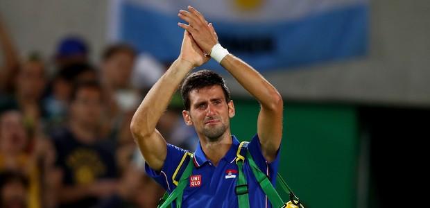 Djokovic chora após ser eliminado no Rio (Foto: Clive Brunskill/Getty Images)