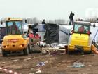 Destruição parcial de acampamento de migrantes de Calais prossegue