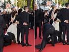 Homem enfia a cabeça debaixo de vestido de America Ferrera em Cannes