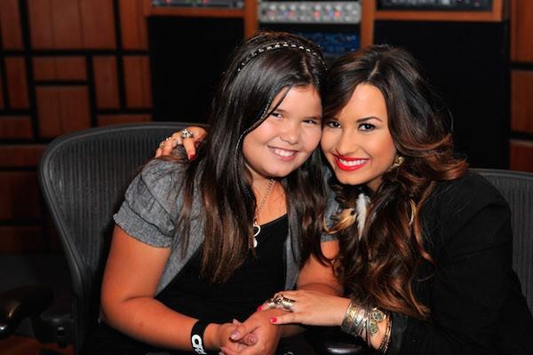A cantora Demi Lovato com a irmã mais nova (Foto: Getty Images)