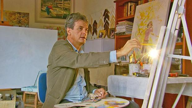 Lona de caminhão é tela para pintura que saiu de Minas Gerais para Paris (Foto: Devanir Gino/TG)