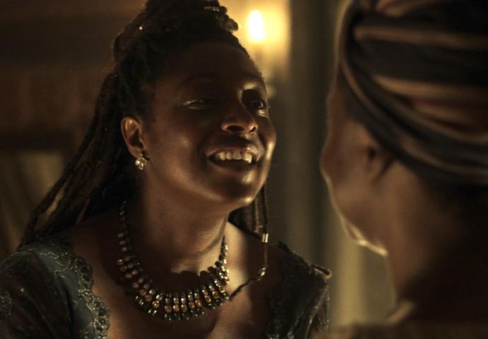 Jacinta conta para Celeste que ela está livre (Foto: TV Globo)