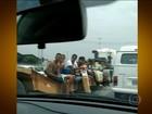Caroneiros arriscam a vida viajando pendurados; veja flagrantes