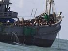 Mianmar escolta barco repleto de imigrantes para área 'segura'