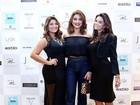 Juliana Paes vai a evento de beleza com as irmãs