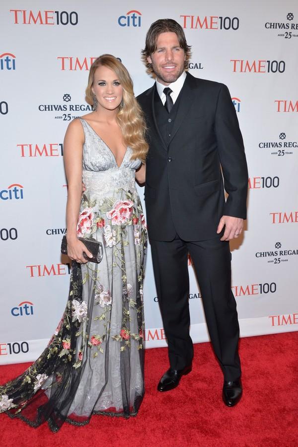 A cantora Carrie Underwood e seu marido, o jogador de hockey Mikey Fisher (Foto: Getty Images)