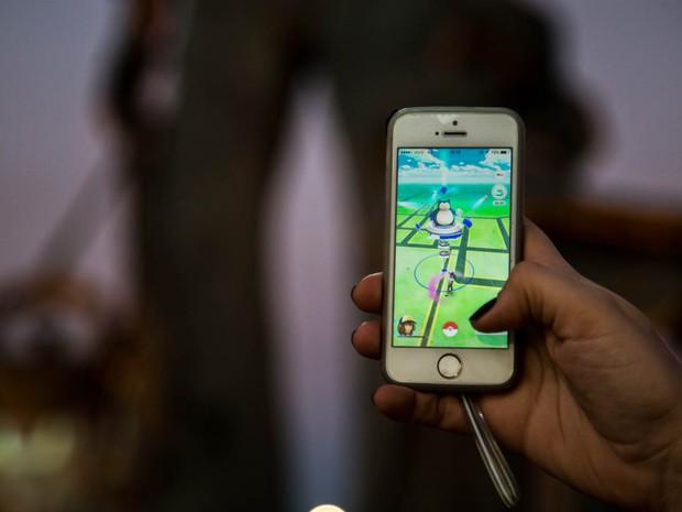 Monumento ao peão é ginásio de batalha de Pokémons na Festa de Barretos (Foto: Mateus Rigola/G1)