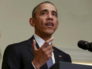 Barack Obama fala na Casa Branca sobre o acordo climático fechado neste sábado (12) em Paris (Foto: REUTERS/Yuri Gripas)