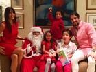Após boatos de crise no casamento, Marcos Mion posa com a família