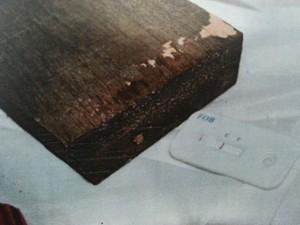 Auxiliar de serviços gerais teria usado pedaço de madeira ao tentar mater a filha Goiás (Foto: Reprodução/DIH)