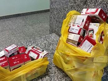 Embalagens de aparelhos celulares que seriam furtados de loja  (Foto: Polícia Militar/Reprodução)