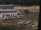 Seca dos rios em Manaus revela lixo e degradação ambiental em marina