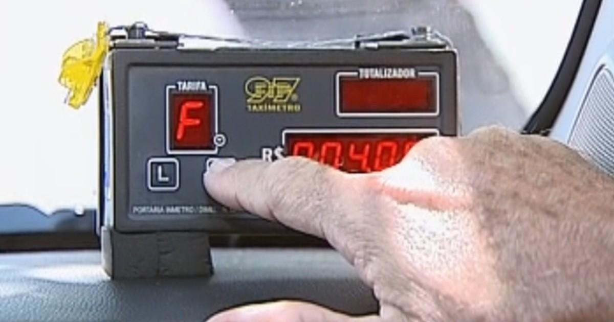 TEM Notícias flagra irregularidades na cobrança dos taxistas de ... - Globo.com