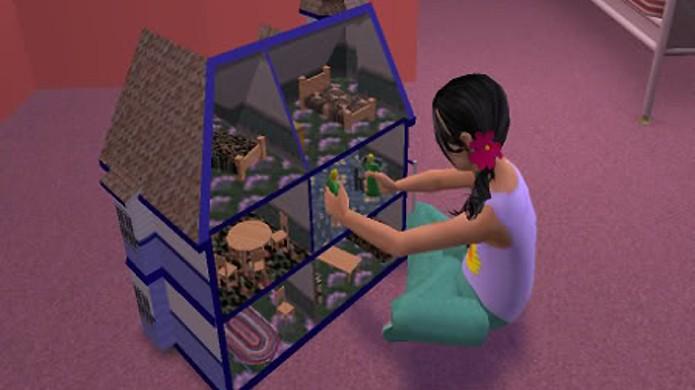Uma menina brinca com uma casa de bonecas dentro de um jogo considerado uma casa de bonecas virtual (Foto: silvervaleprosperity.blogspot.com)