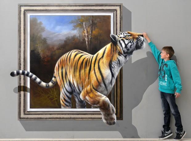 O pequeno Dustin parece fazer carinho em tigre que 'sai' de quadro 3D (Foto: Hendrik Schmidt/AFP)