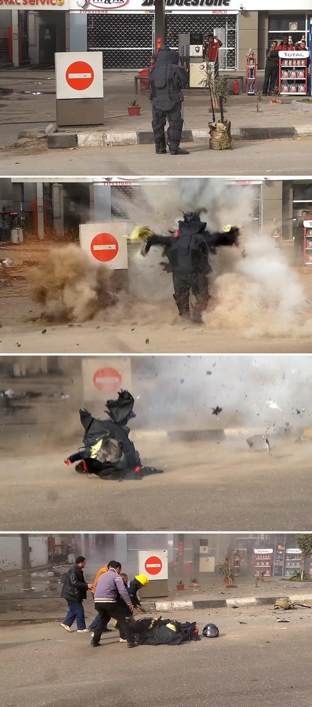 Sequência mostra o momento em que policial é atingido por explosão na avenida Al-Harram, no Cairo, na terça (6) (Foto: AFP Photo/Al-Youm al-Saabi)