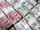 Iuan desvaloriza a nível mais fraco desde março de 2011