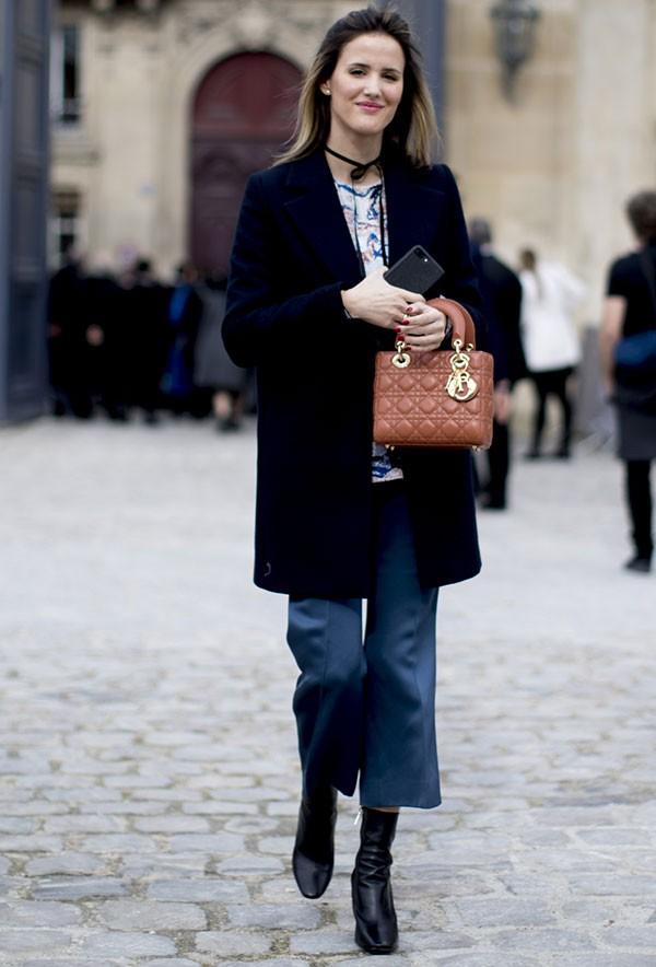 Inverno: calça midi combinada com bota é uma opção (Foto: ImaxTree)