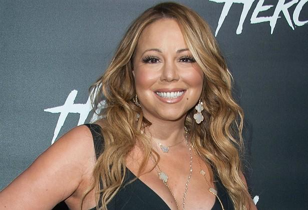 Mariah Carey e o ex-marido, o também músico Nick Cannon, estão sendo processados por uma babá que afirma ter trabalhado 100 horas por semana, sem pausas para dormir nem se alimentar, e sem receber pelas horas extras. A mulher cuidava dos gêmeos do casal: a menina Monroe e o menino Moroccan, nascidos em abril de 2011. (Foto: Getty Images)