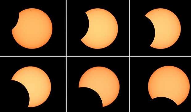 Combinação de seis fotos mostra a lua cruzando a frente do sol. (Foto: AFP Photo)