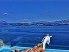 Ex-BBB Renatinha posa de biquíni cavado em cenário paradisíaco