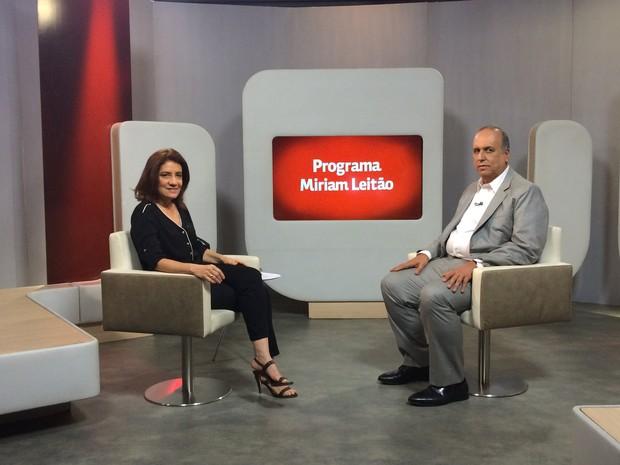 Míriam Leitão e Luiz Fernando Pezão (Foto: GloboNews)