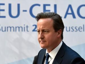 O primeiro-ministro britânico David Cameron chega à cúpula da União Europeia e da CELAC em Bruxelas, na quarta-feira (10) (Foto: AFP Photo/Philippe Huguen)