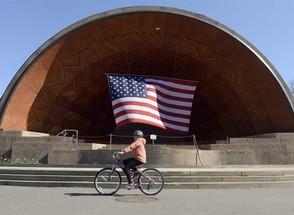 Balanços positivos de empresas dos EUA surpreendem