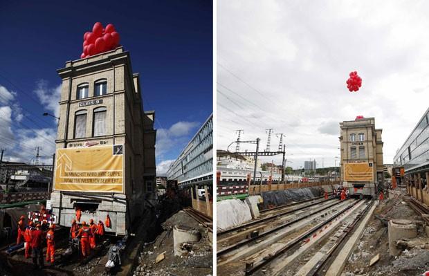 Preocupada em manter intacto o prédio histórico de uma estação de trens na Suíça, uma empresa investiu cerca de 12 milhões de francos suíços (R$ 26 milhões) para usar trilhos e mover a construção 120 metros para o lado. (Foto: Michael Buholzer/Reuters)