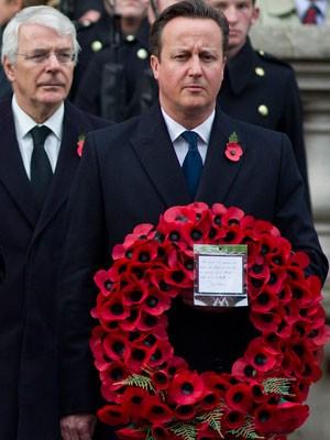 Primeiro-ministro britânico, David Cameron, durante o 'Domingo da lembrança', em homenagem ao armistício assinado entre Alemanha em Aliados, que colocou fim à 1ª Guerra Mundial. (Foto: Justin Taliis/France Presse)