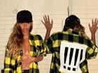 Beyoncé sensualiza em ensaio e posa sem sutiã, com camisa aberta