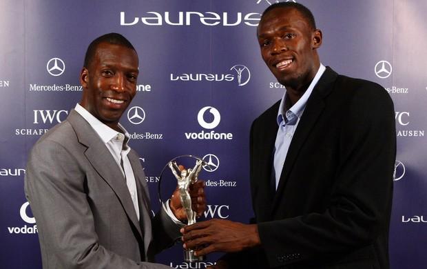 Michael Johnson e Usain Bolt com o Premio Laureus (Foto: Getty Images)