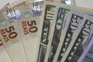 notas real dólar (Foto: Ricardo Moraes/Reuters)