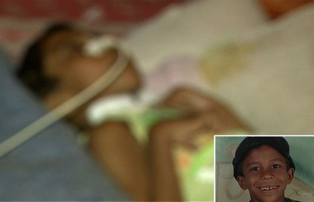 Sobrevivente de chacina, menino luta para conseguir tratamento em Goiânia, Goiás (Foto: Reprodução / TV Anhanguera)