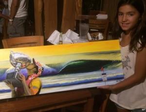 Sophia Medina mostra quadro pintado por Hilton Alves em homenagem ao irnão (Foto: Carol Fontes)