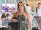 Após decisão judicial favorável, Joana Machado viaja com cara séria