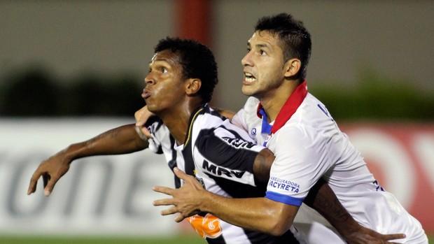 Jô e José Caceres Atlético-MG x Nacional (Foto: AFP)