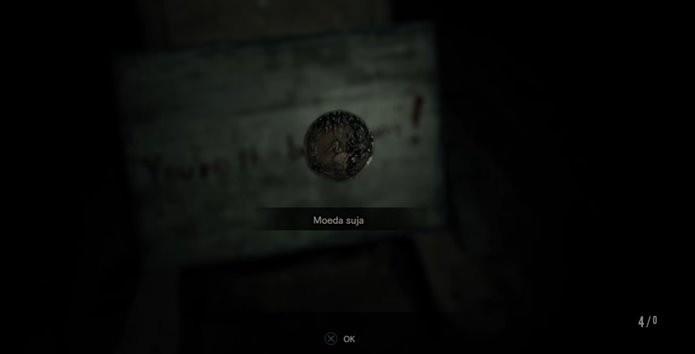 Moeda obtida na demo deve liberar conteúdo na versão final de Resident Evil 7 (Foto: Reprodução/Felipe Demartini)