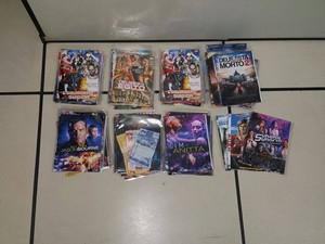 DVDs foram apreendidos com dois suspeitos (Foto: PM / Divulgação)