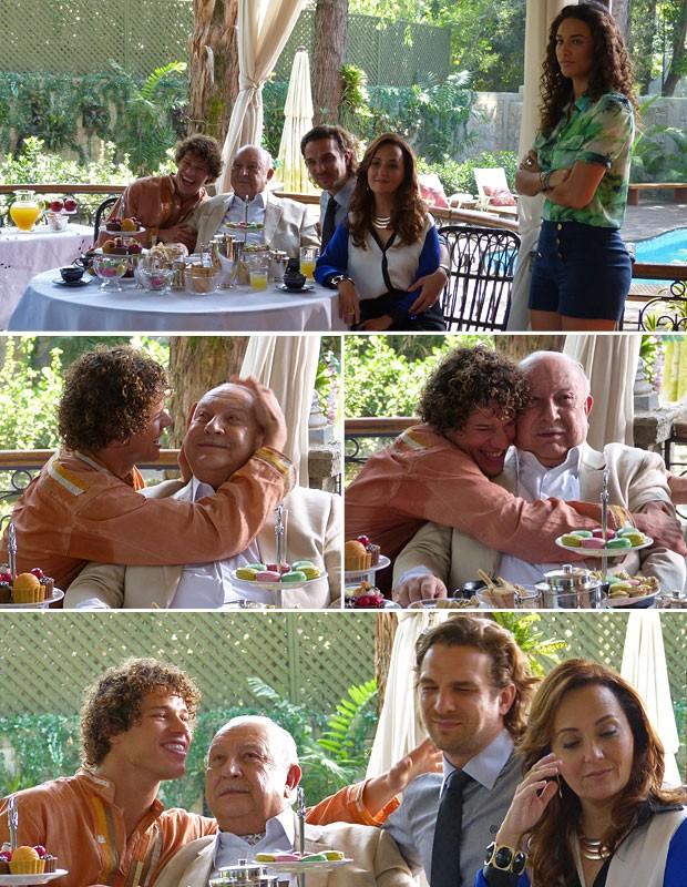 Dionísio se esforça para parecer feliz nas fotos ao lado de Candinho (Foto: Flor do Caribe / TV Globo)