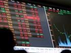 Bovespa fecha em baixa após reduzir perdas de mais de 3%