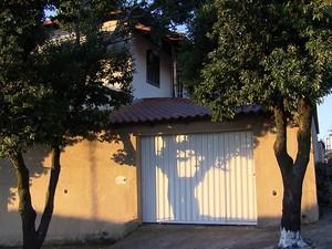Pai e filho estavam em casa qundo crime aconteceu (Foto: Reprodução/TV Globo)