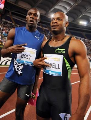 Bolt e Asafa Powell (Foto: Agência AFP)