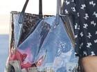 Flagra revela notas de cem dólares em bolsa de Paris Hilton