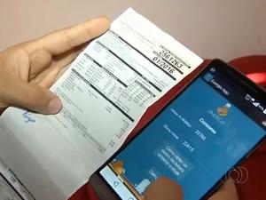 Aplicativo diz quanto o consumidor gastou de energia elétrica (Foto: Reprodução/TV Anhanguera)