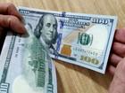 Dólar sobe, com movimento de ajuste e seguindo exterior