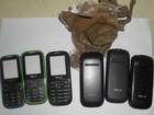 Mulheres tentam entrar em presídio com 'carcaças' de celulares e droga
