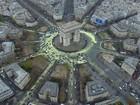 Ativistas do Greenpeace escalam Arco do Triunfo por energia renovável