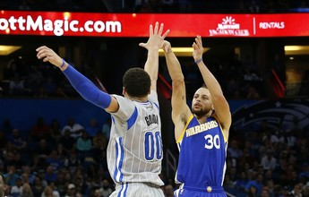 Curry e Thompson combinam para 14 bolas de três, e Warriors batem Magic