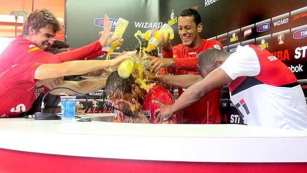 €45m PSG signing Lucas Moura drenched by team mates at final Sao Paulo press conference